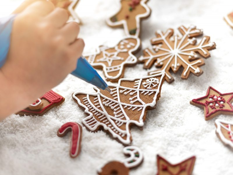 Close up of pâtissier icing festive gingerbread
