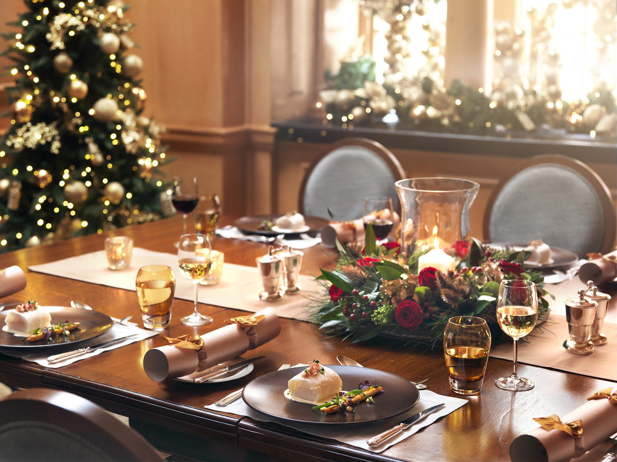 Festive table setting with Christmas tree