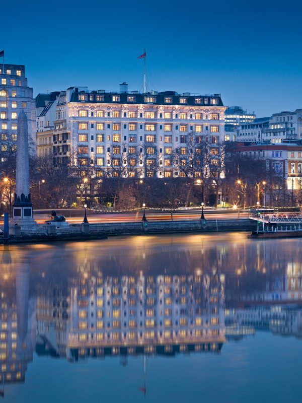 The Savoy building exterior reflecting in the river